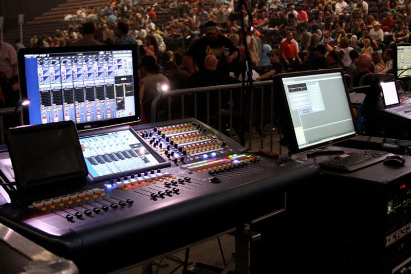 Image of digital mixer console at live concert
